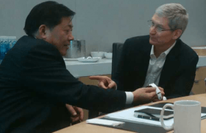 Tim Cook and a Chinese official discussing the Apple Watch